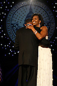 Washington, DC - January 20, 2009 -- United States President Barack Obama and First Lady Michelle Obama attend the Neighborhood Inaugural Ball at the Washington Convention Center on January 20, 2009 in Washington, DC. Obama became the first African-American to be elected to the office of President in the history of the United States.  .Credit: Chip Somodevilla - Pool via CNP