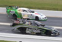 Apr. 28, 2013; Baytown, TX, USA: NHRA funny car driver Alexis DeJoria (near lane) races alongside Jack Beckman during the Spring Nationals at Royal Purple Raceway. Mandatory Credit: Mark J. Rebilas-