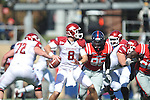 Arkansas quarterback Tyler Wilson (8) passes as Ole Miss' Bryon Bennett (95) rushes at Vaught-Hemingway Stadium in Oxford, Miss. on Saturday, October 22, 2011. .