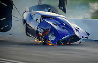 Jun. 18, 2011; Bristol, TN, USA: NHRA pro mod driver Roger Burgess crashes  after winning the first round race during eliminations at the Thunder Valley Nationals at Bristol Dragway. Mandatory Credit: Mark J. Rebilas-