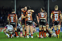 Jonny Hill of Exeter Chiefs embraces team-mate Harry Williams at the final whistle. European Rugby Champions Cup match, between Exeter Chiefs and the Ospreys on January 24, 2016 at Sandy Park in Exeter, England. Photo by: Patrick Khachfe / JMP