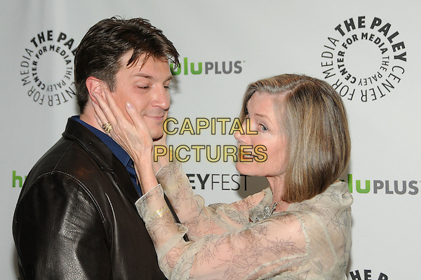 "Nathan Fillion, Susan Sullivan.PaleyFest 2012 Presents ""Castle"" held at The Saban Theatre, Beverly Hills, California, USA, 9th March 2012..half length jacket black leather blue shirt hands touching face cream beige print .CAP/ADM/BP.©Byron Purvis/AdMedia/Capital Pictures."