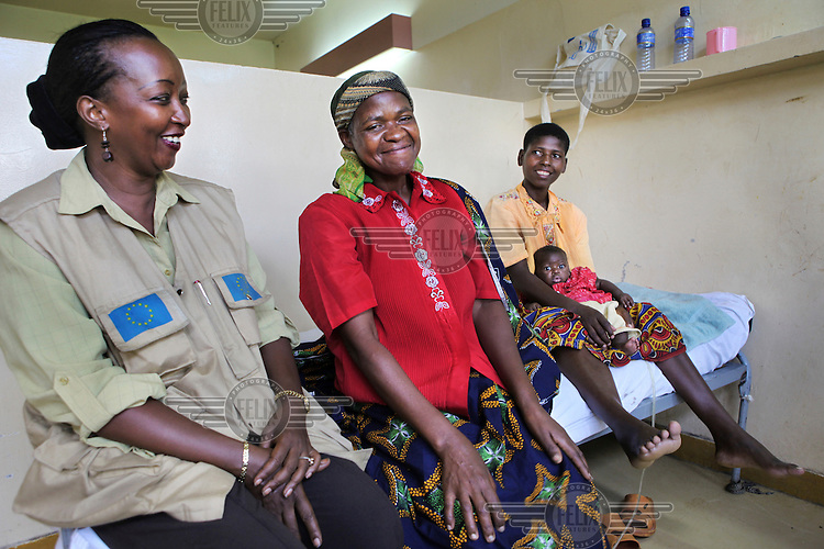 50 year old Adele (centre) received a fistula operation in the University Hospital of Kamenge in Bujumbura. For 15 years she lived with fistula, a hole in the birth canal which she got after a prolonged labour. For years she smelled of leaking urine and her legs burned from the acid in the urine. After getting fistula she still gave birth to two babies, but both died in infancy. After her husband died Adele decided to return to her home village in the province of Ngozi. But there she was also excluded socially and not accepted in church or at the market because of the bad smell. Left untreated, fistula can lead to chronic medical problems, including ulcers and kidney disease. A simple surgical procedure can normally repair the injury, but the problem in Burundi is that there is no-one trained to perform the operation. Adele's operation was possible thanks to an initiative of Handicap International and Gynecologie Sans Frontieres.