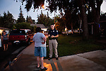 Delta Haweye Security guard Darien Wilson reprimands a woman for using illegal fireworks in a Stockton, Calif. neighborhood, July 11, 2012. The bankrupt city has cut back on many services, while residents and private contractors are picking up the slack.