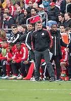 Toronto, Ontario - May 17, 2014: Toronto FC head coach Ryan Nelsen watches the action during a game between the New York Red Bulls and Toronto FC at BMO Field. Toronto FC won 2-0.