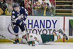 10 February 2017: University of New Hampshire Wildcat Forward Tyler Kelleher, a Senior from Longmeadow, MA, works for puck control over University of Vermont Catamount Forward Travis Blanleil, a Junior from Kelowna, British Columbia, in the first period at Gutterson Fieldhouse in Burlington, Vermont. The Wildcats came from behind to defeat the Catamounts 4-2 in the first game of their 2-game Hockey East Series. Mandatory Credit: Ed Wolfstein Photo *** RAW (NEF) Image File Available ***