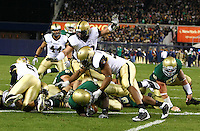 Notre Dame's running back Robert Hughes scores on a 1 yard run to give Notre Dame a 10-3 lead over Army at Yankee Stadium on Saturday, November 20, 2010. Photo by Errol Anderson