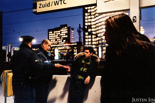 Ticket controllers penalise a youngster who did not pay his metro fare at the Zuid/WTC station in south Amsterdam. .Picture taken 2005 by Justin Jin