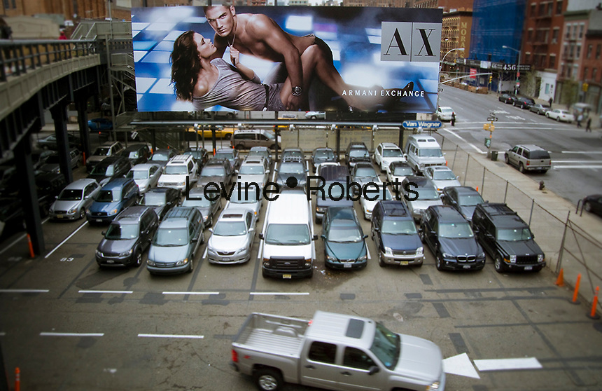 A billboard for Emporio Armani is seen from the new High Line Park in the New York neighborhood of Chelsea on Friday, October 23, 2009.  (© Richard B. Levine)