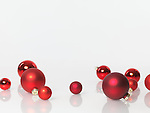 Christmas decoration ornament. Red glass baubles isolated on white background with copy space.