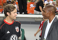 Eddie Pope with old teammate Carey Talley #8 of D.C. United during an MLS match against the Los Angeles Galaxy at RFK Stadium on July 18 2010, in Washington D.C. Galaxy won 2-1.