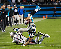 The Carolina Panthers play the New England Patriots at Bank of America Stadium in Charlotte North Carolina on Monday Night Football.  The Panthers defeated the Patriots 24-20.  Carolina Panthers tight end Greg Olsen (88), New England Patriots free safety Devin McCourty (32)