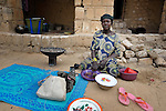 A woman drinks tea in Timbuktu, a city in northern Mali which was seized by Islamist fighters in 2012 and then liberated by French and Malian soldiers in early 2013. This woman belongs to the Bella ethnic group, which has traditionally been exploited by the region's lighter-skinned groups.