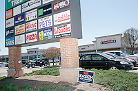 A campaign sign for Republican presidential candidate John Kasich is seen near the sign for the Airport Plaza strip mall in Warwick, Rhode Island, USA, on Sun., Apr. 24, 2016. The Kasich campaign has set up operations in the campaign headquarters of Warwick mayor Scott Avedisian at Airport Plaza. The Trump and Cruz campaigns also have based their state operations in Airport Plaza.