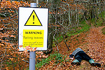 Spoof warning sign - Falling leaves - and victim of carelessness