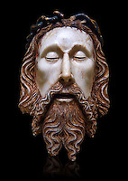 Gothic statue of the Head of Christ by  Jaume Cascalls. Carved alabaster with polychrome and gilt remains.  This head must have belonged to a Recumbent Christ which could have formed part of a sculptural group of the Holy Sepulchre. It probably came from the chapel of Corpus Christi of the convent of Sant Agust&iacute; Vell, Barcelona.<br /> Jaume Cascalls is one of the most important sculptors of the fourteenth century in Catalonia. This is borne out by his involvement over almost thirty years with the project of the royal pantheon in Poblet for King Peter the Ceremonious and with other large undertakings of the time. Today, on stylistic grounds, he is credited with this 'Head of Christ', which must have formed part of a sculptural group of the Holy Sepulchre, presumably from the church of the convent of Sant Agust&iacute; Vell in Barcelona. The break in the neck suggests it belonged to a full-length recumbent Christ, like the one kept at Sant Feliu in Girona and also attributed to Cascalls. National Museum of Catalan Art, inv no: 034879-000
