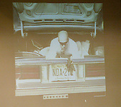 A video showing law enforcement personal simulating a person laying in the trunk of a Chevrolet Caprice and firing a weapon is displayed on a screen during the trial of sniper suspect John Allen Muhammad in Virginia Beach Circuit Court in Virginia Beach, Virginia, November 6, 2003.  The judge has not decided if he will allow the jury to view the video. <br /> Credit: Tracy Woodward - Pool via CNP