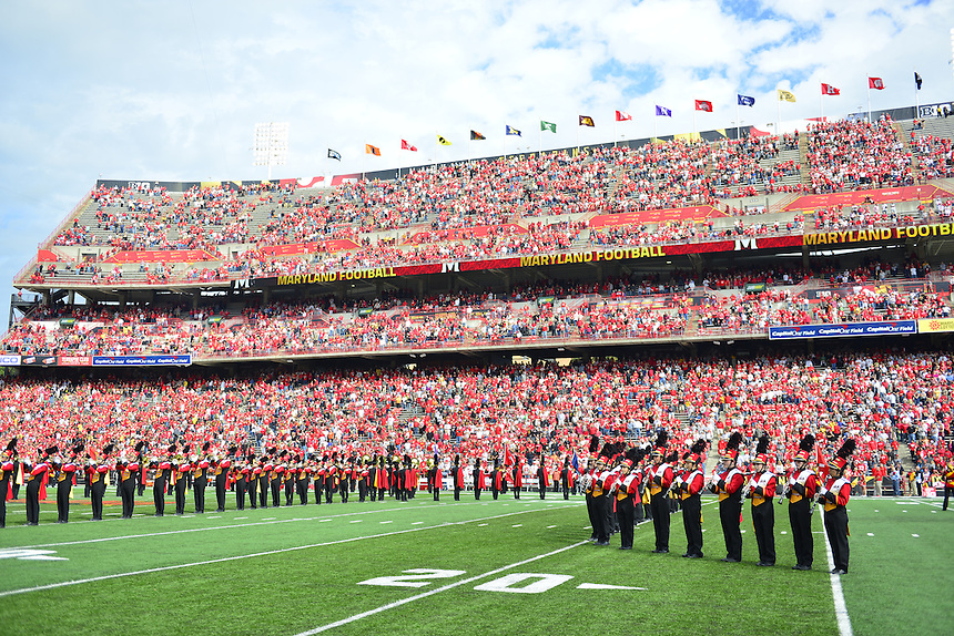 The fans stand to attention during the singing of the National Anthem prior to kick-off between Ohio State and  Maryland at the Capital One Field in Byrd Stadium, College Park, MD on Saturday, October 4, 2014.  Alan P. Santos/DC Sports Box