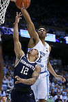 28 December 2016: North Carolina's Tony Bradley (5) blocks a shot by Monmouth's Justin Robinson (12). The University of North Carolina Tar Heels hosted the Monmouth University Hawks at the Dean E. Smith Center in Chapel Hill, North Carolina in a 2016-17 NCAA Division I Men's Basketball game. UNC won the game 102-74.