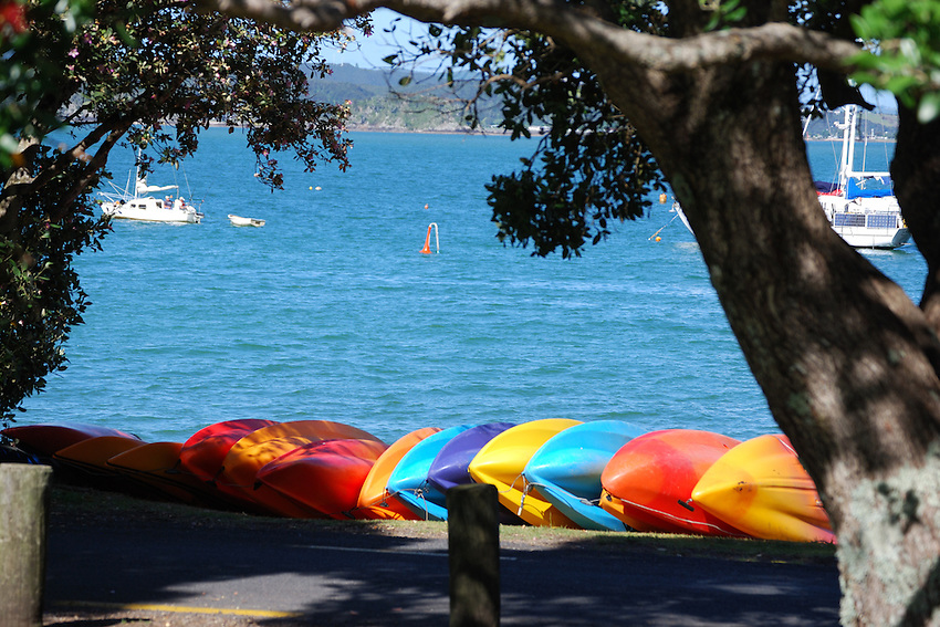 Colors of Bennetton - Canoes waiting for hire, Russell, New Zealand
