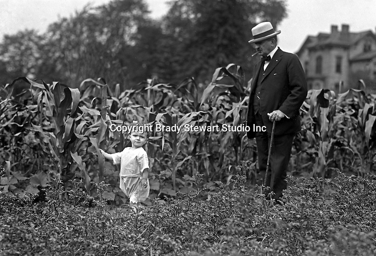 Point Breeze:  Brady Stewart's favorite subjects to photograph were family and friends.  Homer and Helen Stewart walking in the backyard Victory Garden - 1918.  During this time the Stewart's lived at 6705 Thomas Street in Point Breeze