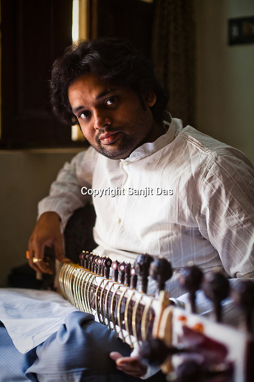34 year old Sitar player, Deobrat Mishra poses for a portrait in his house in Varanasi, Uttar Pradesh, India. Photograph: Sanjit Das/Panos