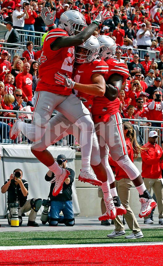 Ohio State Buckeyes wide receiver Austin Mack (11) and Ohio State Buckeyes tight end A.J. Alexander (88) jump to celebrate the touchdown by Ohio State Buckeyes wide receiver Parris Campbell (21) in the third quarter of their game at Ohio Stadium in Columbus, Ohio on October 1, 2016. (Columbus Dispatch photo by Brooke LaValley)
