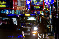 Hailing a Black taxi cab on Regent Street, London, United Kingdom