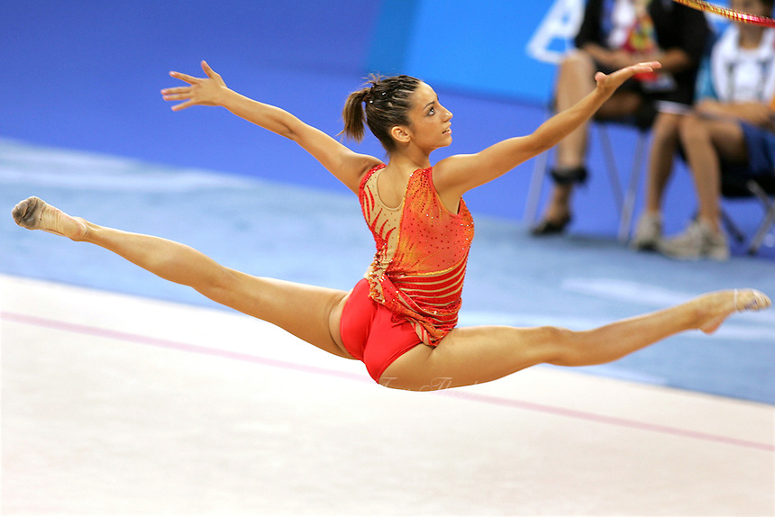 August 29, 2004; Athens, Greece; Rhythmic gymnastics star ALMUDENA CID of Spain split leaps to recatch hoop in All-Around competition at 2004 Athens Olympics. Almudena Cid has made history by being the only rhythmic gymnast ever to make 3 Olympic finals.<br /> Copyright 2004 Tom Theobald