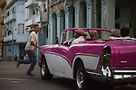 HAVANA, CUBA -- MARCH 23, 2015:  A classic car driver gives a tour in Havana, Cuba on March 23, 2015. Photograph by Michael Nagle