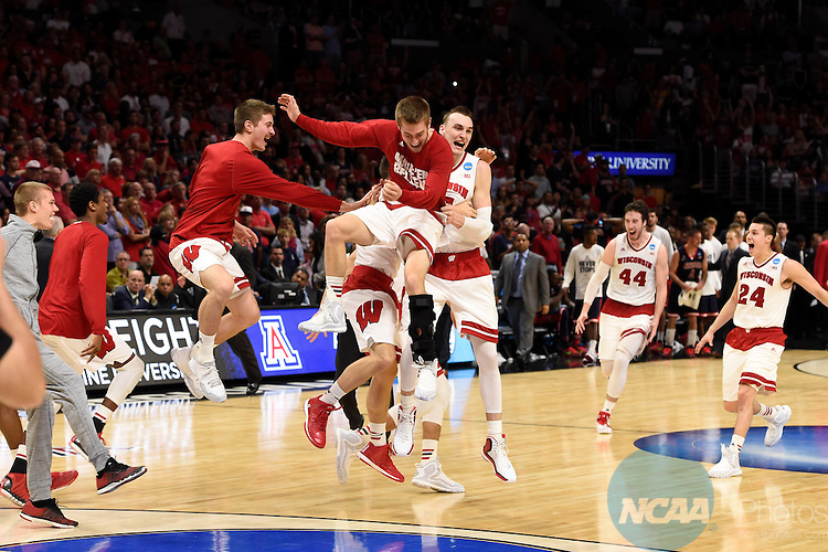 28 MAR 2015:  The University of Wisconsin celebrates their victory over the University of Arizona during the 2015 NCAA Men's Basketball Tournament held at the Staples Center in Los Angeles, CA.  Wisconsin defeated Arizona 85-78 to advance to the Final Four.  Jamie Schwaberow/NCAA Photos