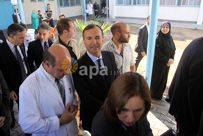 Italian Foreign Minister Franco Frattini, is accompanied by members of his delegation and security personnel as he visits the Al-Sweede United Nation's hospital in Gaza City, on 24 November 2010 . Photo by Mohammed Asad