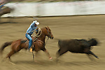 A cowboy tries for the heals of a steer during team roping at the Jordan Valley Big Loop Rodeo, Ore.