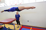 A member of the Los Altos High School gymnastics team completes a vault.