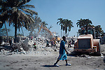 People dig through the rubble of the ministry of foreign affairs, which collapsed in the recent earthquake, in Port-au-Prince, Haiti.