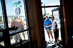Developer Bernie Carter, center right, chats with tenant Jonathan Bascom, right, who's opening a coffee shop in Reno, Nevada's Midtown district, July 6, 2012.