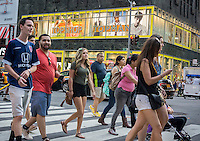 Crowds of shoppers pass the Topshop/ Topman store on Fifth Avenue in Midtown Manhattan in New York on Tuesday, May 26, 2015. (© Richard B. Levine)