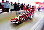 18 December 2010: Patrice Servelle pushes his 2-man bobsled for Monaco, finishing in 9th place at the Viessmann FIBT World Cup Bobsled Championships on Mount Van Hoevenberg in Lake Placid, New York, USA. Mandatory Credit: Ed Wolfstein Photo