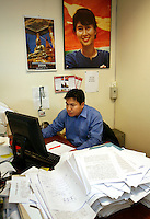 Journalist Htet Aung Kyan working at his desk. Democratic Voice of Burma is radio and TV station run by exiled Burmese. Opposing the government, the DVB has been transmitting, from the Norwegian capitol Oslo, into Burma since 1992.