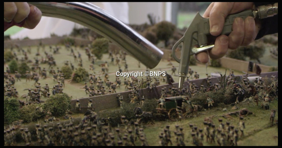 BNPS.co.uk (01202 558833)<br /> Pic: PhilYeomans/BNPS<br /> <br /> Stills from the video: Kelvin and Mary Thatcher at work.<br /> <br /> Historic battle brought back to life...<br /> <br /> A stunning diorama of the battle of Waterloo has been restored to its former glory after a painstaking cleaning operation to remove nearly 50 years of dust.<br /> <br /> The sweeping panorama contain's 21,500 figures and nearly 10,000 horses, each of which has been meticulously cleaned by hand over the last five months by husband and wife team Kelvin and Mary Thatcher from Norfolk.<br /> <br /> The pristine model has now gone back on display at the refurbished Royal Green jackets museum in Winchester.<br /> <br /> A sobering fact is that there were over twice as many casualties in the actual battle as there are figures on the diorama.