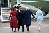 First Lady Melania Trump and former First Lady Michelle Obama walk with United States President Donald Trump who puts his arm around former President of the United States Barack Obama as they walk to Marine One at the Capitol Building after Trump is sworn in at the 58th Presidential Inauguration on Capitol Hill in Washington, D.C. on January 20, 2017.   <br /> Credit: John Angelillo / Pool via CNP