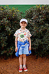 Stuart Murphy, 4, of Alexandria, Virginia, poses for a portrait outside of Gate 6 of the Augusta National Golf Club on the first tournament day of The Masters Golf Tournament in Augusta, Georgia April 8, 2010. It is Stuart's first time at The Masters.