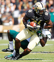 WEST LAFAYETTE, IN - SEPTEMBER 15:  Tight end Gabe Holmes #86 of the Purdue Boilermakers is tackled from behind by defensive back Pudge Cotton #7 of the Eastern Michigan Eagles at Ross-Ade Stadium on September 15, 2012 in West Lafayette, Indiana. (Photo by Michael Hickey/Getty Images)***Local Caption***Gabe Holmes; Pudge Cotton