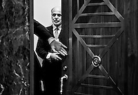 Federal Reserve chaIrman Ben Bernanke waits to enter the hearing room for his confirmation hearing in the Senate Banking, Housing and Urban Affairs Committee to continue as chairman of the Board of Governors of the Federal Reserve on Dec. 3, 2009.