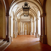 The entrance to the palazzo apartments is through this grand barrel-vaulted gallery with a terracotta tiled floor