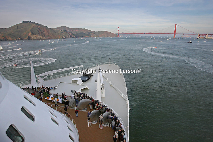 Passengers pack the top decks of the Queen Mary 2, grandest ocean liner ever built, while the ship streams under the Golden Gate Bridge in San Francisco. Queen Mary 2's arrived under the Golden Gate Bridge was cause for celebration.
