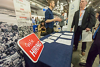 AlphaPoint announces tis hiring at the TechDay New York event on Tuesday, April 18, 2017. Thousands attended to seek jobs with the startups and to network with their peers. TechDay bills itself as the U.S.'s largest startup event with over 500 exhibitors. (© Richard B. Levine)