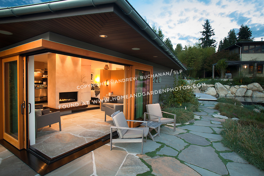 A small guest cottage opens its doors wide to allow indoor-outdoor living. For information on licensing this image, please use the contact button above.