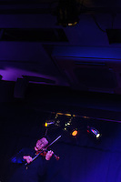 Paul Lazar of Les Oiseaux Noirs Caberet performing in Roppongi, Zero Hour club, Tokyo, Japan, June 27, 2012. The group formed for just four performances in 2012 and mixed song, instrumental performance, pole dancing, tango and yoyo.