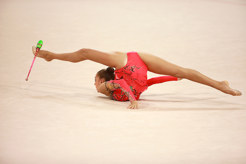 August 22, 2008; Beijing, China; Rhythmic gymnast Evgenia Kanaeva of Russia performs flexibility during clubs routine on way to winning gold in the All-Around final at 2008 Beijing Olympics..(©) Copyright 2008 Tom Theobald